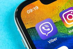 Viber application icon on Apple iPhone X smartphone screen close-up. Viber app icon. Social media icon. Social network. Helsinki, Finland, May 4, 2019: Viber stock photography