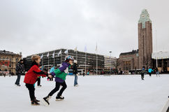 HELSINKI, FINLAND � NOVEMBER 25: skating rink in the city center. Close to the railway station on 25 November, 2012 in Helsinki, Finland Royalty Free Stock Images