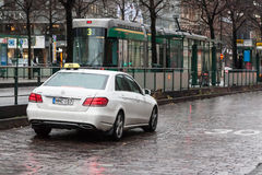 :HELSINKI, FINLAND - OCTOBER 25:taxi on streets of Helsinki, FINLAND - OCTOBER 25 2016.In Finland taxi services enjoy wide popula Royalty Free Stock Photography