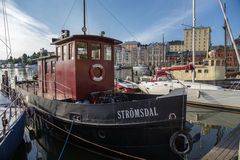 Helsinki, Finland. Old boat at the pier on the waterfront Stock Photography