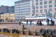 Helsinki. Finland. People feed seagulls Royalty Free Stock Photo