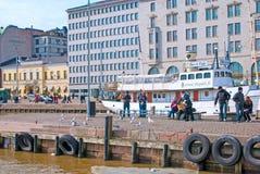 Helsinki. Finland. People feed seagulls Royalty Free Stock Photo