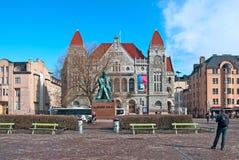 Helsinki. Finland. People near Aleksis Kivi Statue Stock Image