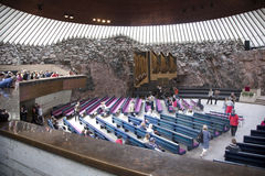 HELSINKI, FINLAND, 14 06 2014: people in the rock church in hels Royalty Free Stock Photo