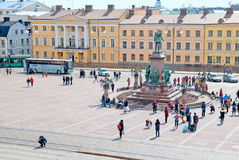 Helsinki. Finland. People on The Senate Square. HELSINKI, FINLAND - APRIL 23, 2016: View to the Senate Square from the Helsinki Cathedral. In the center is Czar Stock Photo