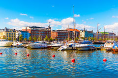 Helsinki, Finland. Scenic summer view of the Old Town architecture and pier with yachts and boats in the Old Port in Helsinki, Finland Stock Photography