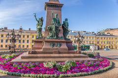 Helsinki, Finland. Senate Square and the pedestal of the monument to Alexander II with sculptures Royalty Free Stock Photo
