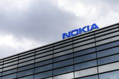 Dark clouds over Nokia logo on top of a building royalty free stock photos