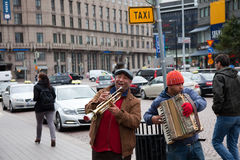 HELSINKI, FINLAND-SEPTEMBER 27: Street musicians play on the st Royalty Free Stock Images