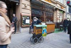 Helsinki. Finland. Street actor. With unusual barrel organ Stock Photos
