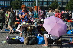 Helsinki, Finland - Street vendors and customers gathered in open air fleamarket Stock Photos