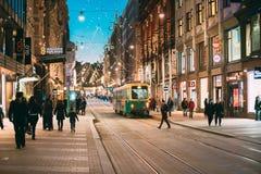 Free Helsinki, Finland. Tram Departs From Stop On Aleksanterinkatu Street. Night Evening Christmas Xmas New Year Festive Stock Photo - 168694650