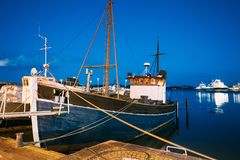 Helsinki, Finland. View Of Fishing Marine Boat, Powerboat At Pier. In Evening Night Illuminations Stock Images