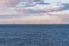 Helsinki in the horizon at sunset with a ship entering the port, Helsinki Finland stock photo
