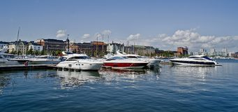 Helsinki marina. Harbour in finland showing the historic skyline and boats Royalty Free Stock Photos