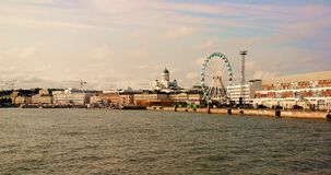 Helsinki panorama. Panorama of Helsinki the capital city of Finland, view of Tuomiokirkko cathedral, harbor and ferris wheel Royalty Free Stock Photography