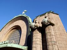 Helsinki Railway Station. The Helsinki Railway Station with two statues and a blue sky Stock Photo