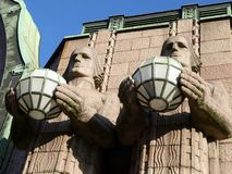 Helsinki Railway Station. The Helsinki Railwaystation, close-up of the two statues Royalty Free Stock Image