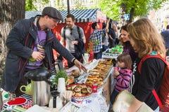 Helsinki Restaurant Day, seller of pies Stock Photos