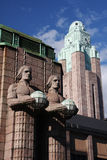 Helsinki train station. Tower of the train station in Helsinki, Finland, with 2 statues carrying globes in front Stock Photo