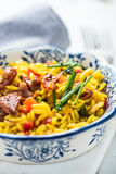 Helthy orzo pasta and rosted tomatos meal Stock Photography