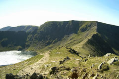 Helvellyn and Striding Edge from Swirral Edge. Helvellyn and Striding Edge seen from Swirral Edge with Red Tarn below in the English Lake District Stock Image