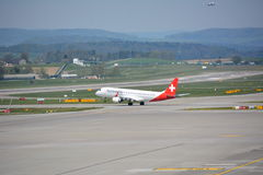 Swiss airplane taking off Stock Images