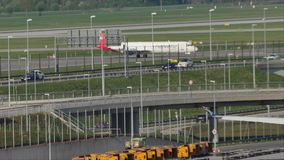 Helvetic Airways plane taxiing in Munich. Helvetic Airways jet doing taxi in Munich Airport, MUC stock video footage
