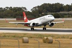 Helvetic Embraer arriving runway 31. Luqa, Malta 5 June 2016: Helvetic Airways Embraer 190LR (ERJ-190-100LR) [HB-JVL] operating a Swiss flight Royalty Free Stock Photo