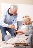 Hem- anhörigvårdare- och pensionärpatient Arkivfoton