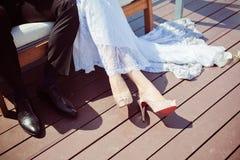 Hem of her dress. Bride shoes. Lace train wedding dress Royalty Free Stock Photo