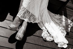 Hem of her dress. Bride shoes. Royalty Free Stock Images