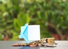 Hem- konkurs och mynt Arkivfoto