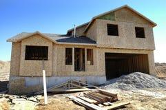 Hem- konstruktion som bygger ett hus för bostads- uppehälle fotografering för bildbyråer