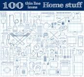 Hem- materialsymboler Uppsättningen av 100 tunn linje objekt i blått färgar på anteckningsboken Royaltyfri Foto