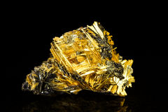 Hematite with rutile in front of black Royalty Free Stock Image