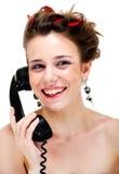 Hembra bastante joven en el teléfono retro Foto de archivo libre de regalías