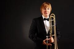 Hembra con el trombone Foto de archivo libre de regalías