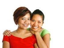 Hembra de dos asiáticos con sonrisas hermosas, Imagen de archivo