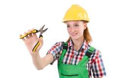 Hembra del trabajador de construcción con los alicates aislados Fotos de archivo