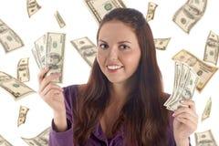 Hembra divertida con los billetes de banco (fondo de los dólares) Imagen de archivo libre de regalías