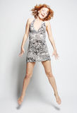 Hembra encantadora joven en el salto del vestido Imagen de archivo libre de regalías