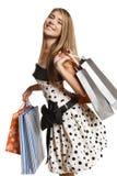 Hembra feliz con los bolsos de compras Imagen de archivo libre de regalías