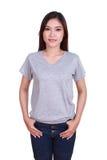 Hembra hermosa joven con la camiseta en blanco Fotografía de archivo