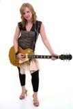 Hembra joven con la guitarra Foto de archivo libre de regalías