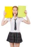 Hembra joven del estudiante con los libros de texto aislados encendido Foto de archivo libre de regalías