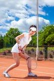 Hembra que juega a tenis Foto de archivo