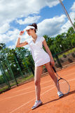 Hembra que juega a tenis Fotografía de archivo libre de regalías