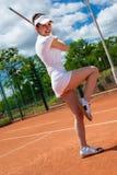 Hembra que juega a tenis Imagenes de archivo