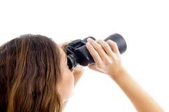 Hembra que mira con binocular Fotografía de archivo